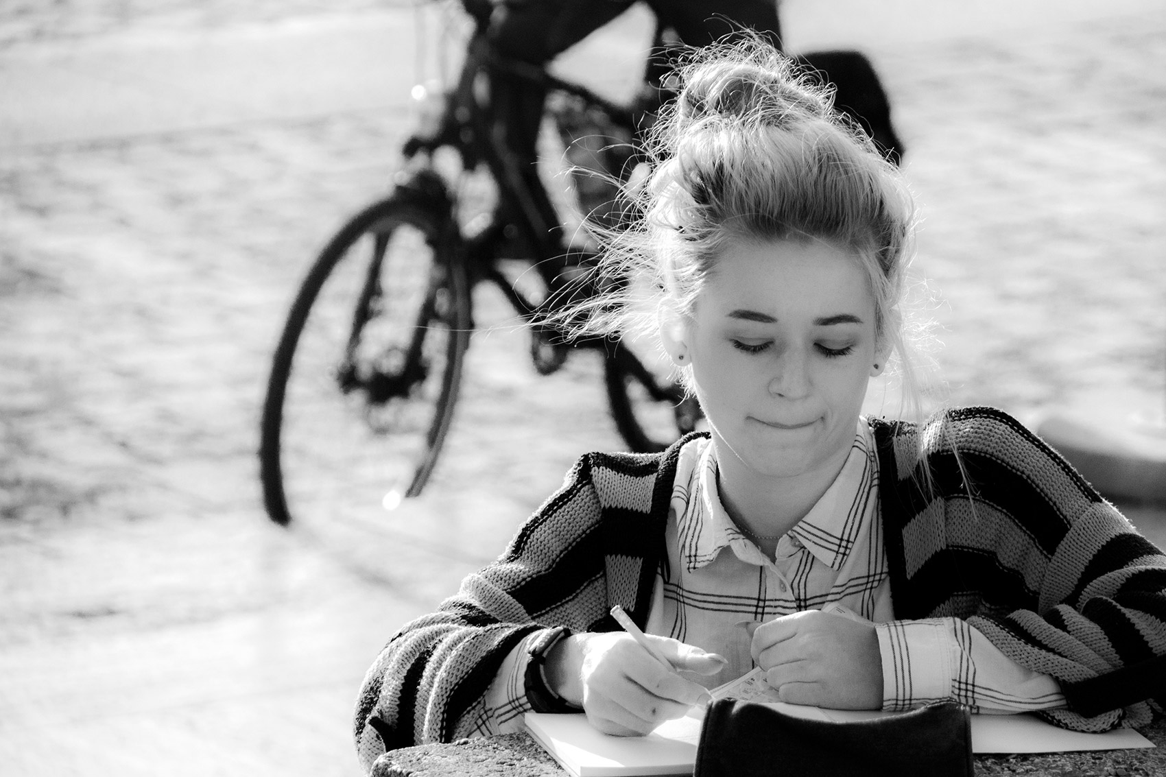 Young girl taking notes in central Rome