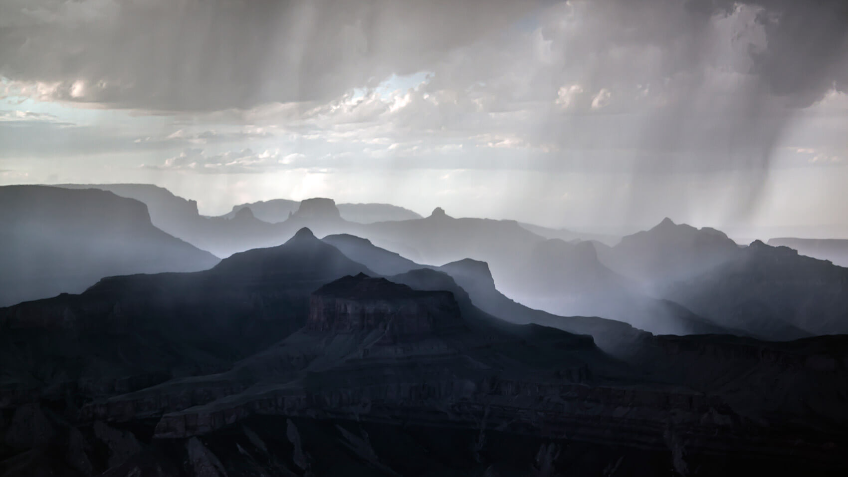 Grand Canyon at sunset with rain