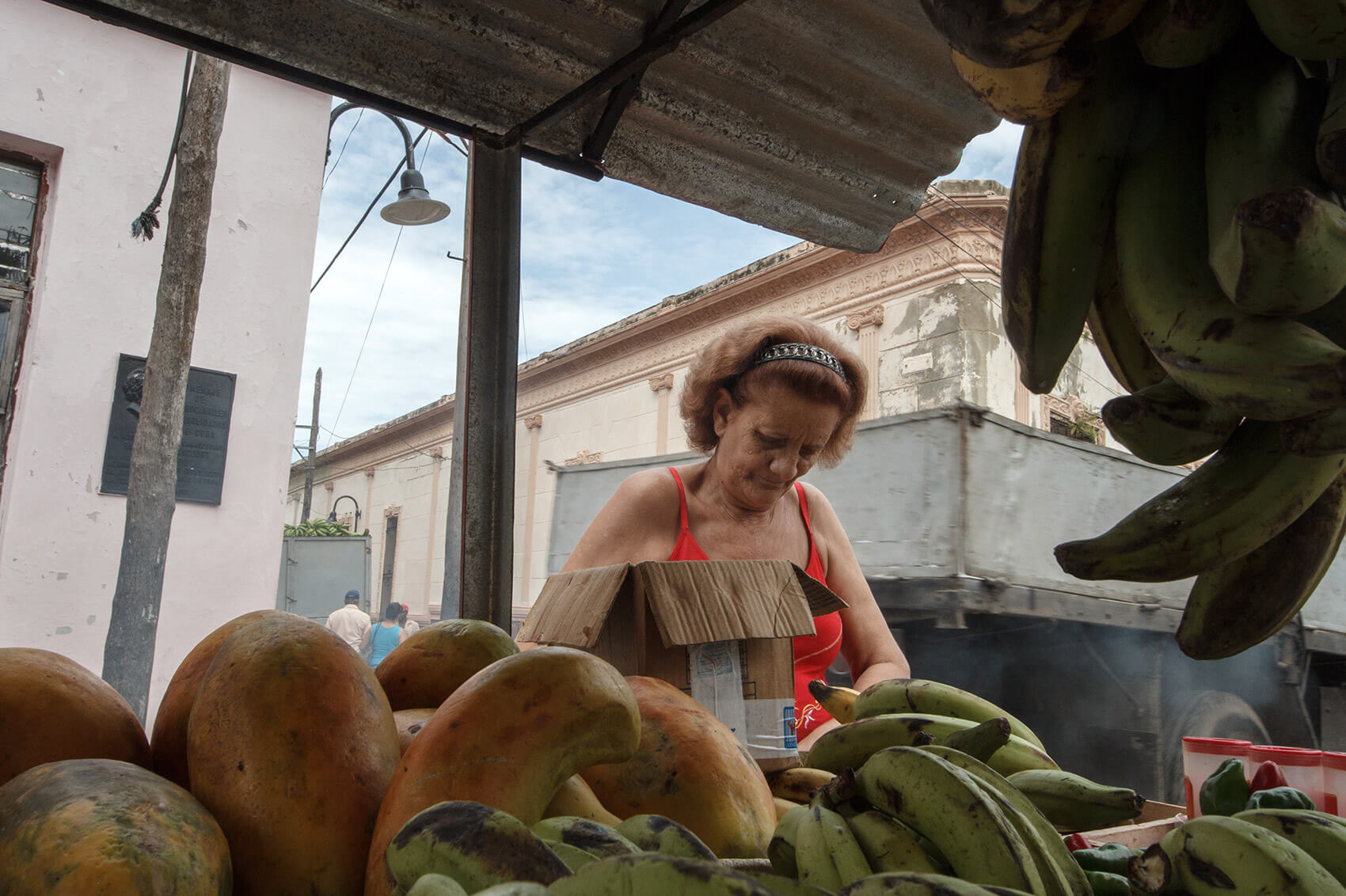 Woman buying fruit in Camagüey, Cuba.