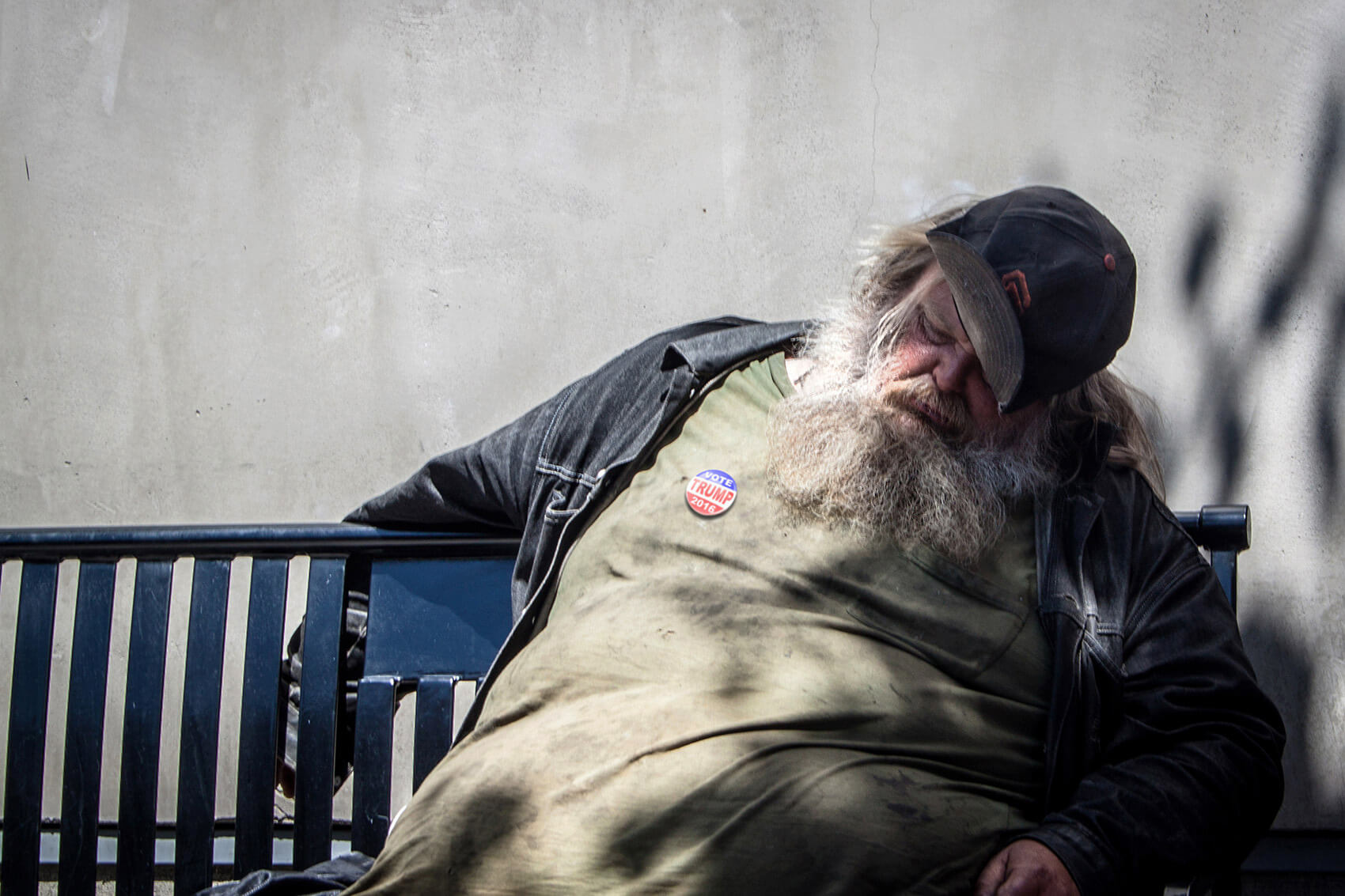 "Homeless with a ""Vote Trump"" badge."