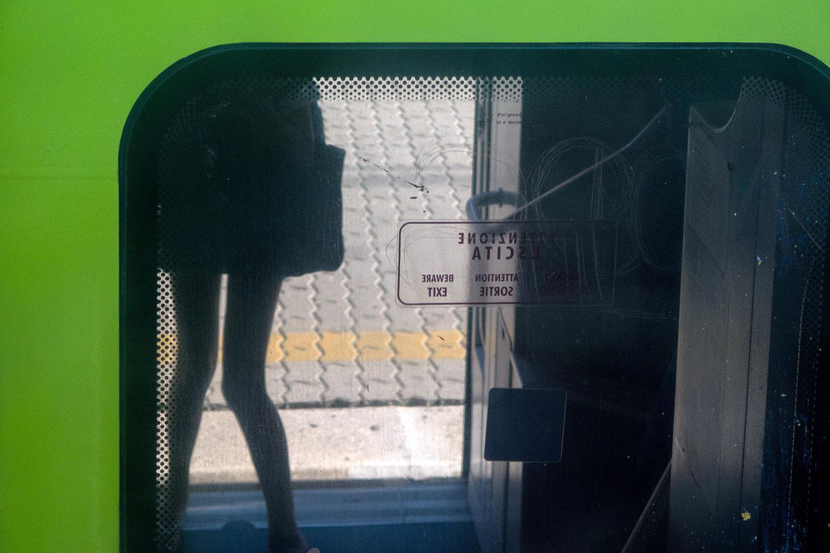 Girl getting into train