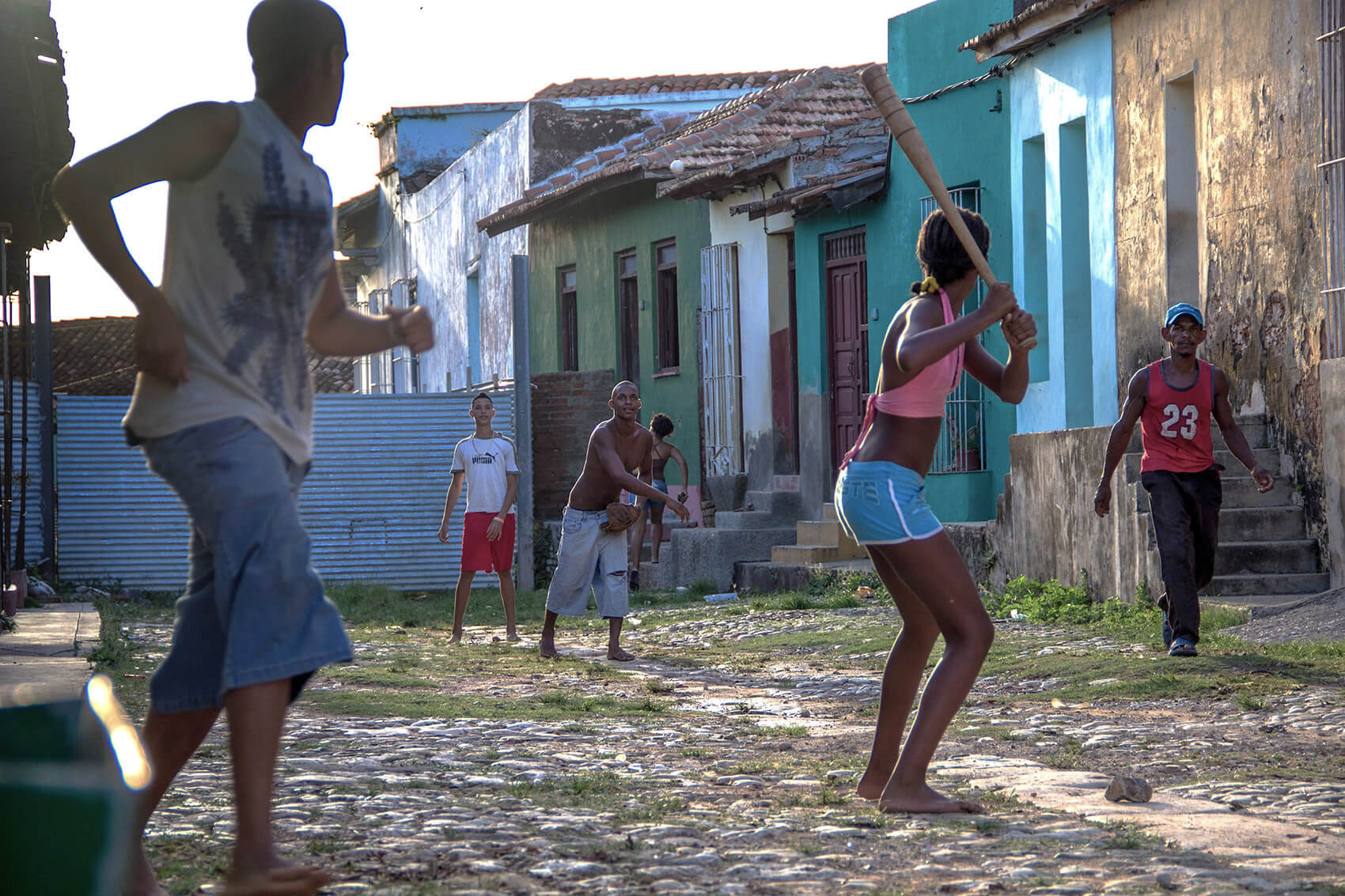 Kids playing baseball in the streets of Trinidad de CubaKids playing baseball in the streets of Trinidad de Cuba