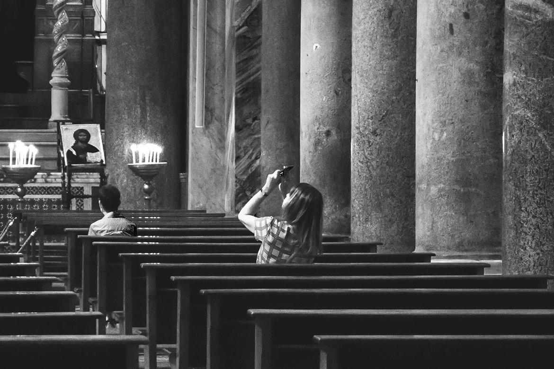 Girl taking photos in a church